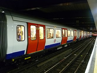 Moorgate station - An S7 Circle line train on a Clockwise service via Liverpool Street viewed from the opposite platform with a C69/77 stock train on a Clockwise service via Paddington on the approach