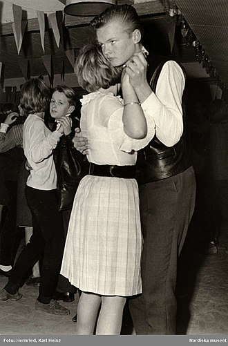 Dance party - Young couples at a school dance in 1950s Sweden.