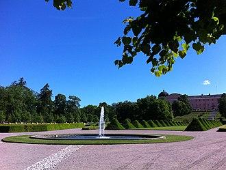 University of Uppsala Botanical Garden - Baroque garden section of Botaniska trädgården with Uppsala Castle in background.