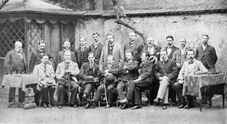 Vienna 1898 chess tournament - Standing: Schwarz, Schlechter, Fahndrich, Caro, Maróczy, Showalter, Marco, Alapin, Halprin, Baird and Burn   Sitting: Tarrasch, Blackburne, Pillsbury, Steinitz, Chigorin, Janowsky, Schiffers and Lipke