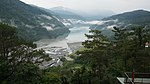 View over Wushe Reservoir with cloudy sky.jpg