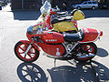 Vintage Yamaha sportbike and Vespa scooter.jpg