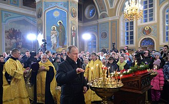 Putin attends the Orthodox Christmas service in the village Turginovo in Kalininsky District, Tver Oblast, 7 January 2016 Vladimir Putin in Pokrova Church (Turginovo) 03.jpg