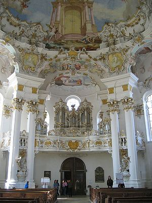 The rococo interior of the church is famous for its frothy trompe-l'oeil plafond.