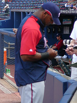 Wily Mo Peña - Peña signing autographs for fans at Turner Field in Atlanta as a member of the Nationals in 2008.