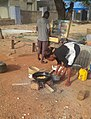 Woman frying akara beans at a local restaurant.jpg