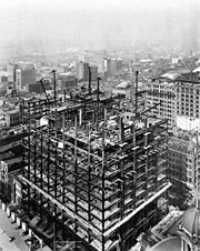 Photographs of steel girders as the Woolworth Building is built