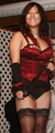 Wrathful Domme in Stockings and Red.png