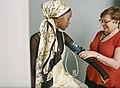 Young woman having her blood pressure taken (48545975471).jpg