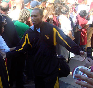 Hershel Dennis - Dennis walking with the USC Trojans to a stadium before a game