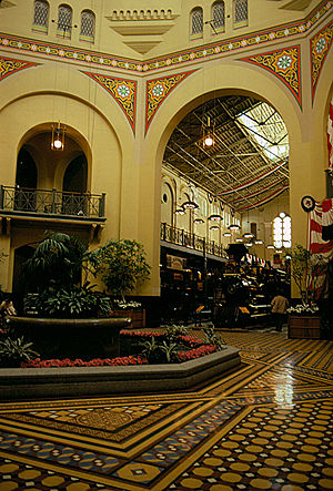 Arts and Industries Building - Interior of the Arts and Industries Building in 1982.  In the background is the Santa Cruz Railroad no. 3 locomotive, placed on display as part of 1876: A Centennial Exhibition.  The engine was displayed here until 1999, when it was moved across the Mall to the National Museum of American History.