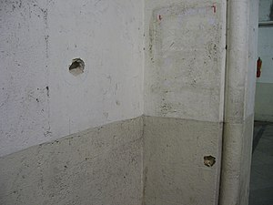 2008 Mumbai attacks - Bullet marks on the wall at CST