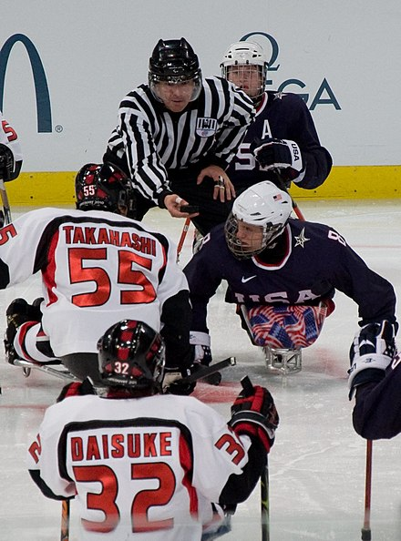 Ice Sledge Hockey: United States (blue shirts) vs Japan (white shirts) during the 2010 Paralympics in Vancouver. 2010ParalympicsIceSledgeHockey.jpg