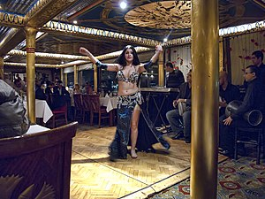 Belly dance - Traditional Egyptian belly dancer in a Cairo Nile River Cruise