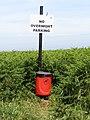 2018-06-24 Sign and dog waste bin, Mundesley Beach.JPG