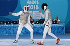 2018-10-09 Bem vs Winterberg-Poulsen (Bronze medal match Boys foil) at 2018 Summer Youth Olympics by Sandro Halank–016.jpg