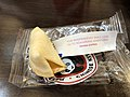 2019-05-11 17 07 43 A broken Chinese fortune cookie with the fortune from the Panda Express at the Fair Oaks Mall in Fair Oaks, Fairfax County, Virginia.jpg