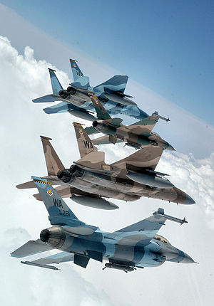 57th Adversary Tactics Group - A flight of Aggressor F-15 Eagles and F-16 Fighting Falcons fly in formation over the Nevada Test and Training Ranges on 5 June 2008. The jets are assigned to the 64th and 65th Aggressor Squadrons at Nellis Air Force Base, Nevada