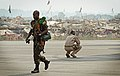 A Rwandan soldier, left, exits a U.S. Air Force C-17 Globemaster III aircraft near a refugee camp full of displaced residents at Bangui M'Poko International Airport in the Central African Republic Jan. 19, 2014 140119-F-RN211-620.jpg