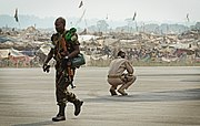 A Rwandan soldier, left, exits a U.S. Air Force C-17 Globemaster III aircraft near a refugee camp full of displaced residents at Bangui M'Poko International Airport in the Central African Republic Jan. 19, 2014 140119-F-RN211-620