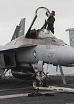 A U.S. Sailor cleans the canopy of an F-A-18E Super Hornet aircraft assigned to Strike Fighter Squadron (VFA) 147 aboard the aircraft carrier USS Nimitz (CVN 68) June 19, 2013, in the Gulf of Oman 130619-N-KE148-133.jpg