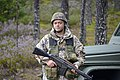 A Zemessarde (Latvian National Guard) pulls security during Strong Guard 2016 near Tukums.jpg