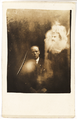 A clergyman and two spirits.png