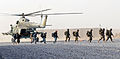 A combined team of Afghan National Army soldiers with the 6th Kandak, 1st Brigade, 205th Corps and Afghan National Police officers board an Mi-17 helicopter assigned to the Kandahar Air Wing on their way to a 120401-N-BS894-008.jpg