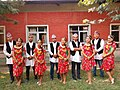 A group of Nepalese Girls and Boys in cultural dress.jpg