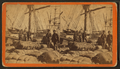 African-American longshore men and bales of cotton on the dock, by Havens..png