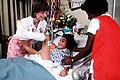 Aided by another staff worker, a pediatric nurse repositions a young patient in a leg cast with skeletal traction at Wilford Hall Medical Center - DPLA - e834006ee1ff70c84ffac439a4537b89.jpeg