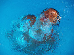 Bubble (physics) - Air bubbles as a man surfaces in a pool.