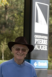 Alan Andrew Watson at the Pierre Auger Observatory sign.jpg