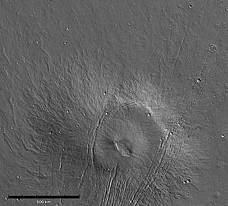 Alba Mons - Lava flows extending north and northwest of Alba Mons. The sinuous ridges are tube- and channel-fed flows. Faint, degraded flows and ridges in the north are part of Alba's broad lava apron (MOLA).