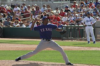Alexi Ogando - Ogando pitching for the Texas Rangers during spring training in 2011