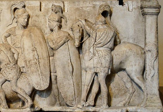 Altar of Domitius Ahenobarbus, c. 122 BC; the altar shows two Roman infantrymen equipped with long scuta and a cavalryman with his horse. All are shown wearing chain mail armour. Altar Domitius Ahenobarbus Louvre n3bis.jpg
