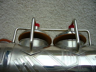 """C.G. Conn - Conn """"Res-O-Pads"""" fitted to the bell-keys on a Selmer 'Pennsylvania Special' alto saxophone, made by Kohlert (Czechoslovakia) in 1938. Note that this instrument has rolled toneholes and that the edge of the pad extends over the rim of the key-cup"""