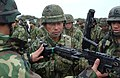 American Soldiers demonstrate the M-249 Squad Automatic Weapon to a Japanese soldier of the 39th Infantry Regiment, Japan Ground Self-Defense Force, during Exercise Orient Shield 2005..jpg