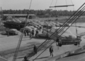 American cars are unloaded at a port on the Shatt al-Arab in 1958.png