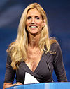 Ann Coulter smiling, with a blue wallpaper behind her.