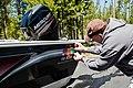 Applying a boat permit sticker (34603269223).jpg