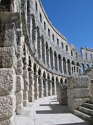 Pula Arena - Restored arched walls at Pula.