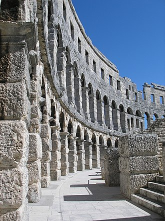 Pula Arena - Restored arched walls at Pula.