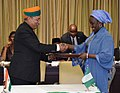 Arjun Ram Meghwal exchanging the Memorandum of Understanding on Trade and Investment with the Nigerian Minster of State for Industry, Trade and Investment, Ms. Aisha Abubakar.jpg