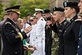 Army Gen. Martin E. Dempsey, chairman of the Joint Chiefs of Staff, stands alongside his wife, Deanie, as he salutes a Reserve Officers Training Corps cadet on the campus of the University of Notre Dame in Sout 140906-D-KC128-484.jpg