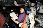 Astronaut Eileen Collins at the Pilot's Station on Shuttle Discovery.jpg