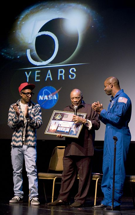 Williams and American astronaut Leland D. Melvin present a montage to record producer Quincy Jones. Astronaut Leland Melvin, and Pharrell Williams present montage to Quincy Jones.jpg