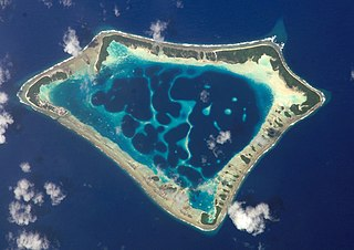Ring-shaped coral reef, generally formed over a subsiding oceanic volcano, with a central lagoon and perhaps islands around the rim
