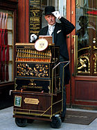 A man in Austria playing his barrel organ. Author : Chepry