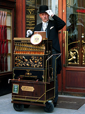 Barrel organ player in Vienna, Austria.